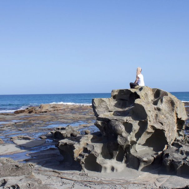 Emili on big rock